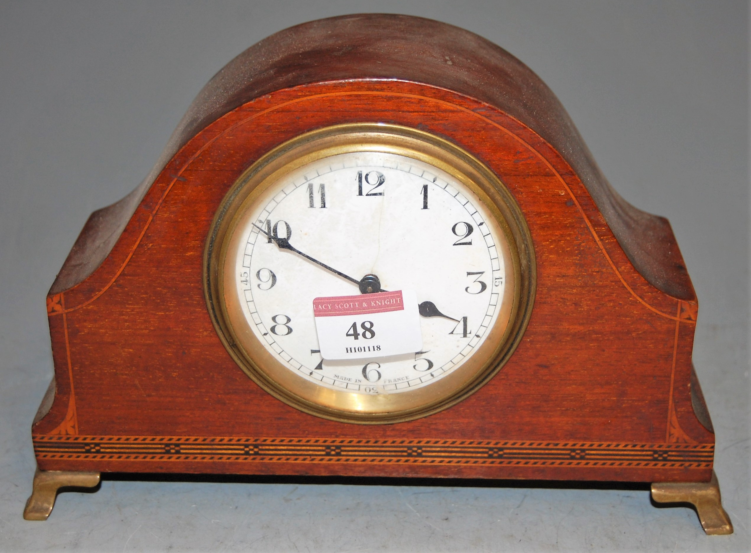 Lot 48 - An Edwardian mahogany and chequer strung mantel clock, having enamelled dial with Arabic numerals