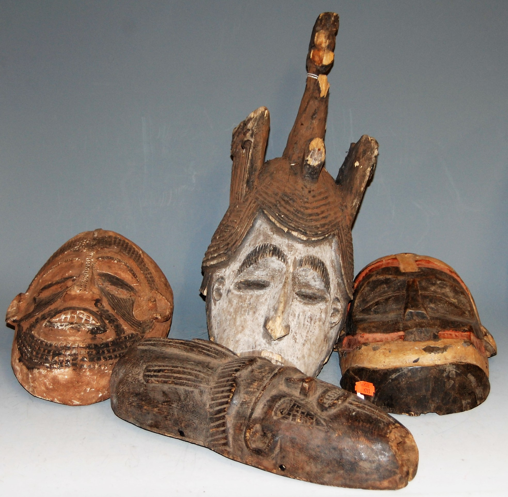 Lot 8 - Four mid-20th century African masks, comprising Punu (Gabonb), Igbo (Nigeria), and two Baule (