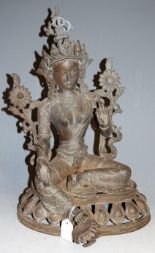 Lot 26 - A late 19th century Tibetan spelter figure of Tara, in typical seated pose (in two parts), h.45cm