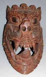 Lot 7 - Two mid-20th century Nepalese wooden masks, the largest 37 x 19cm