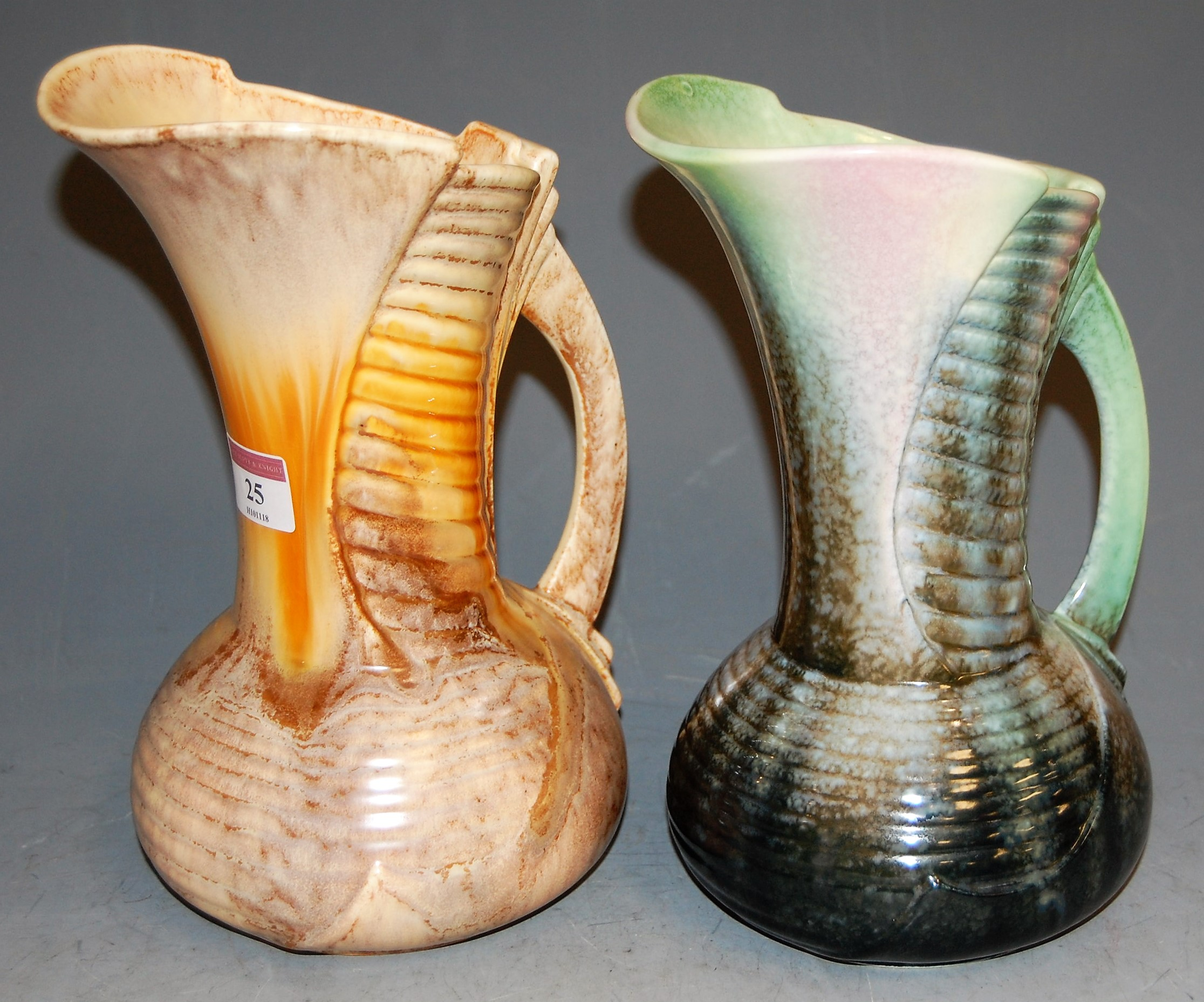 Lot 25 - An Art Deco Sylvac jug, printed mark verso and impressed 1344, h.24cm; together with one other