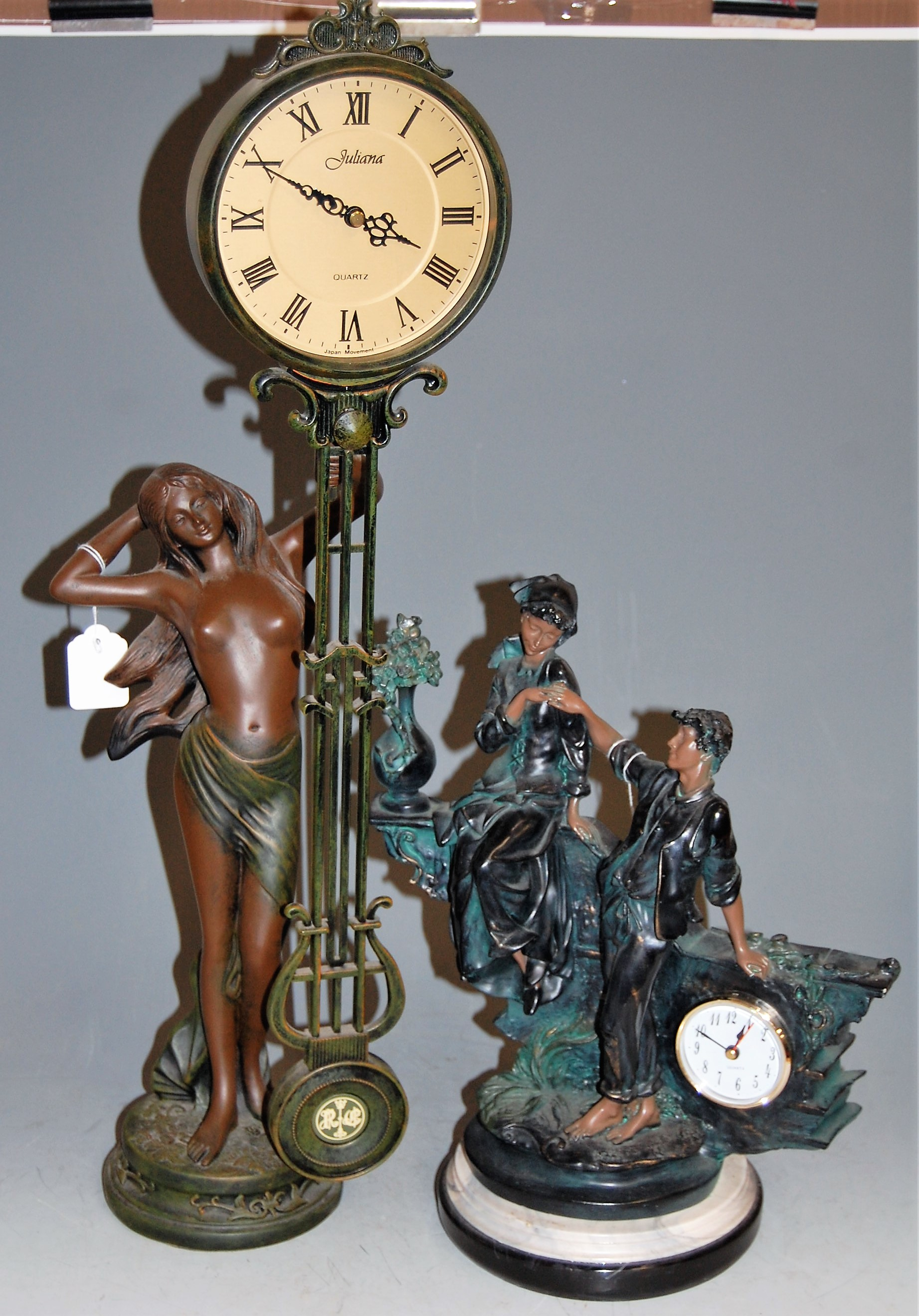 Lot 39 - A reproduction resin figural mantel clock; together with one other Art Nouveau style pendulum