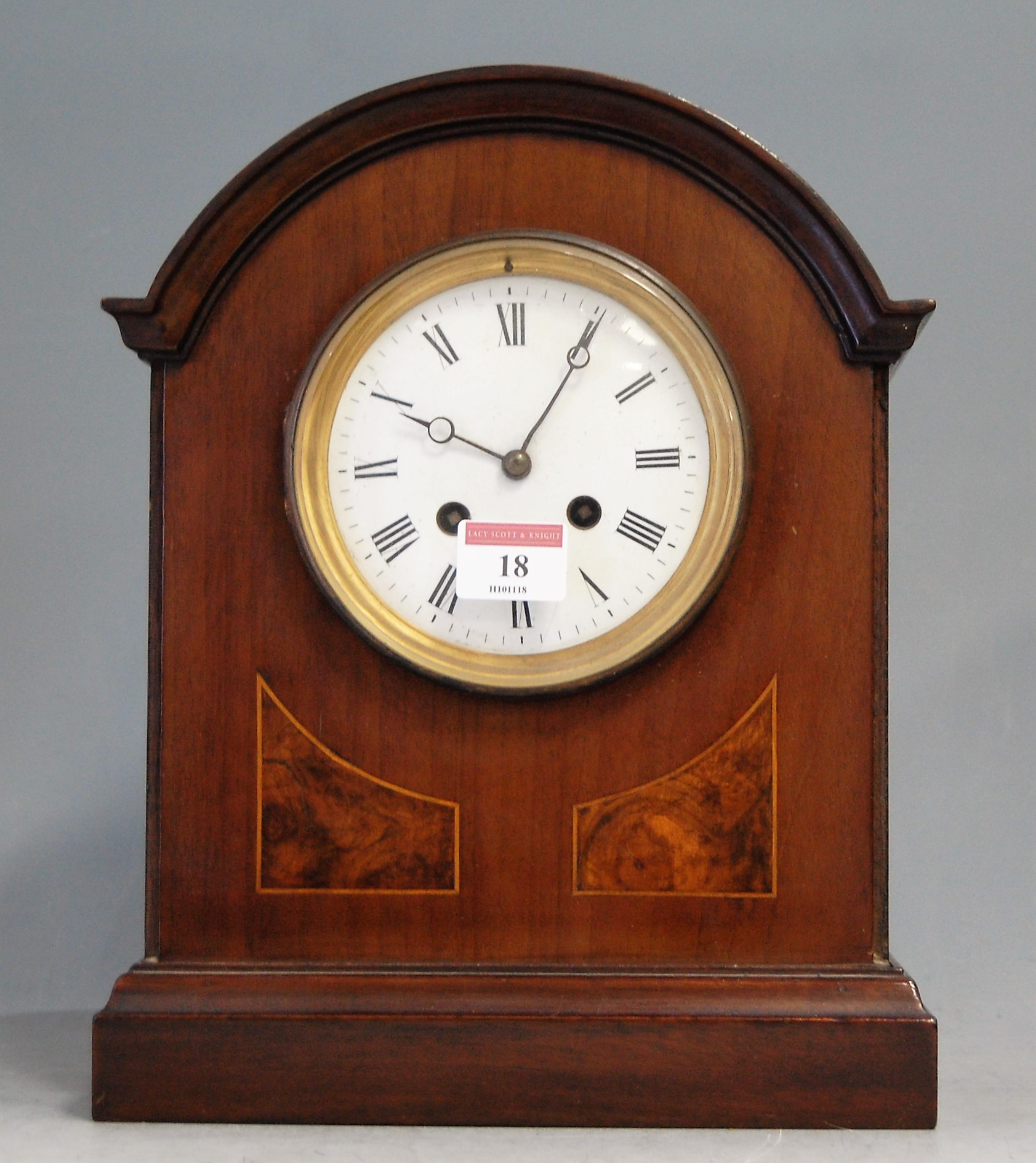 Lot 18 - An Edwardian mahogany cased mantel clock, having enamelled dial with Roman numerals and eight day