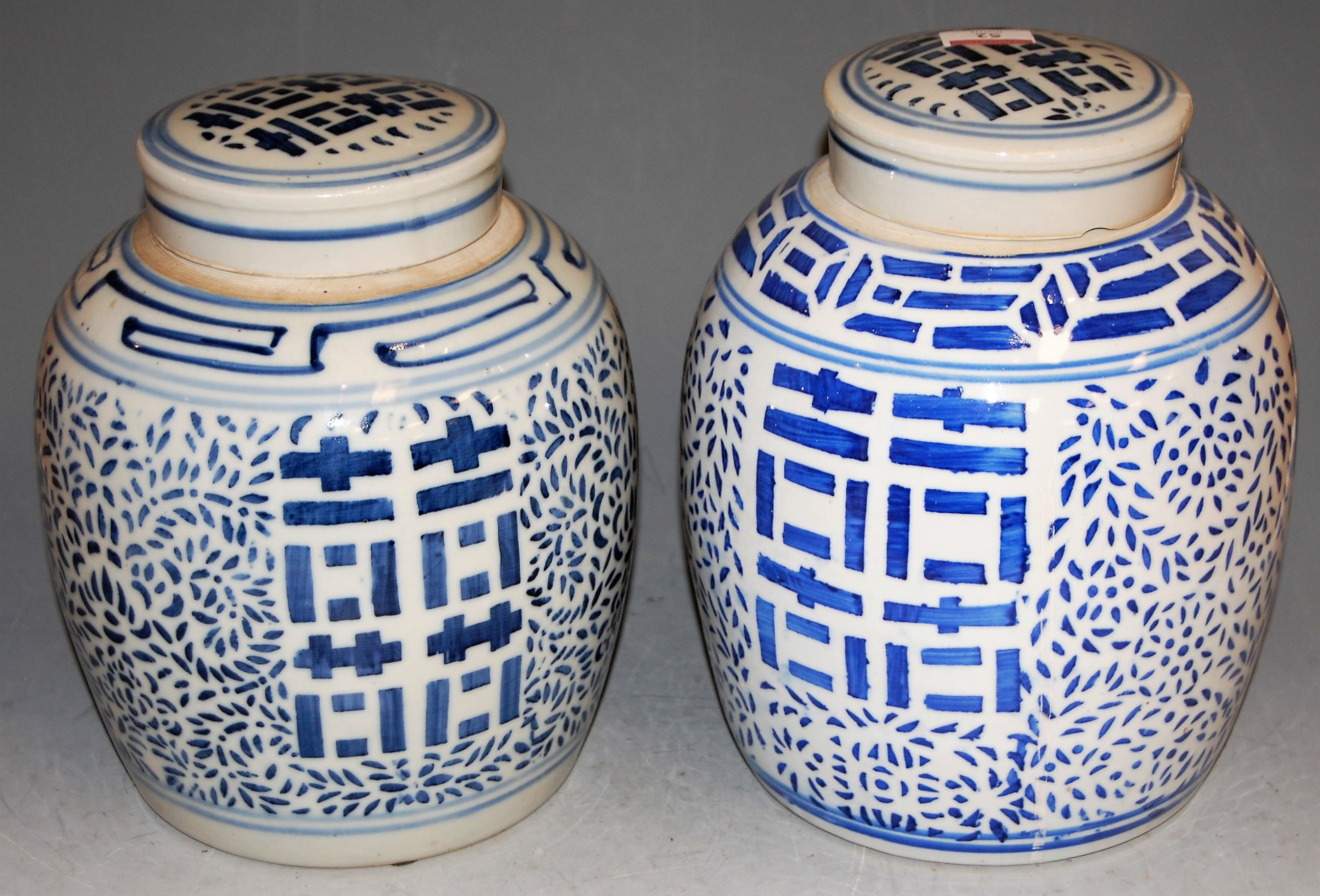Lot 52 - A pair of modern Chinese blue and white ginger jars and covers, h.26cm