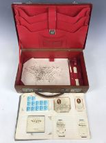 Lot 3 - A leather writing case, together with a collection of cigarette cards etc.