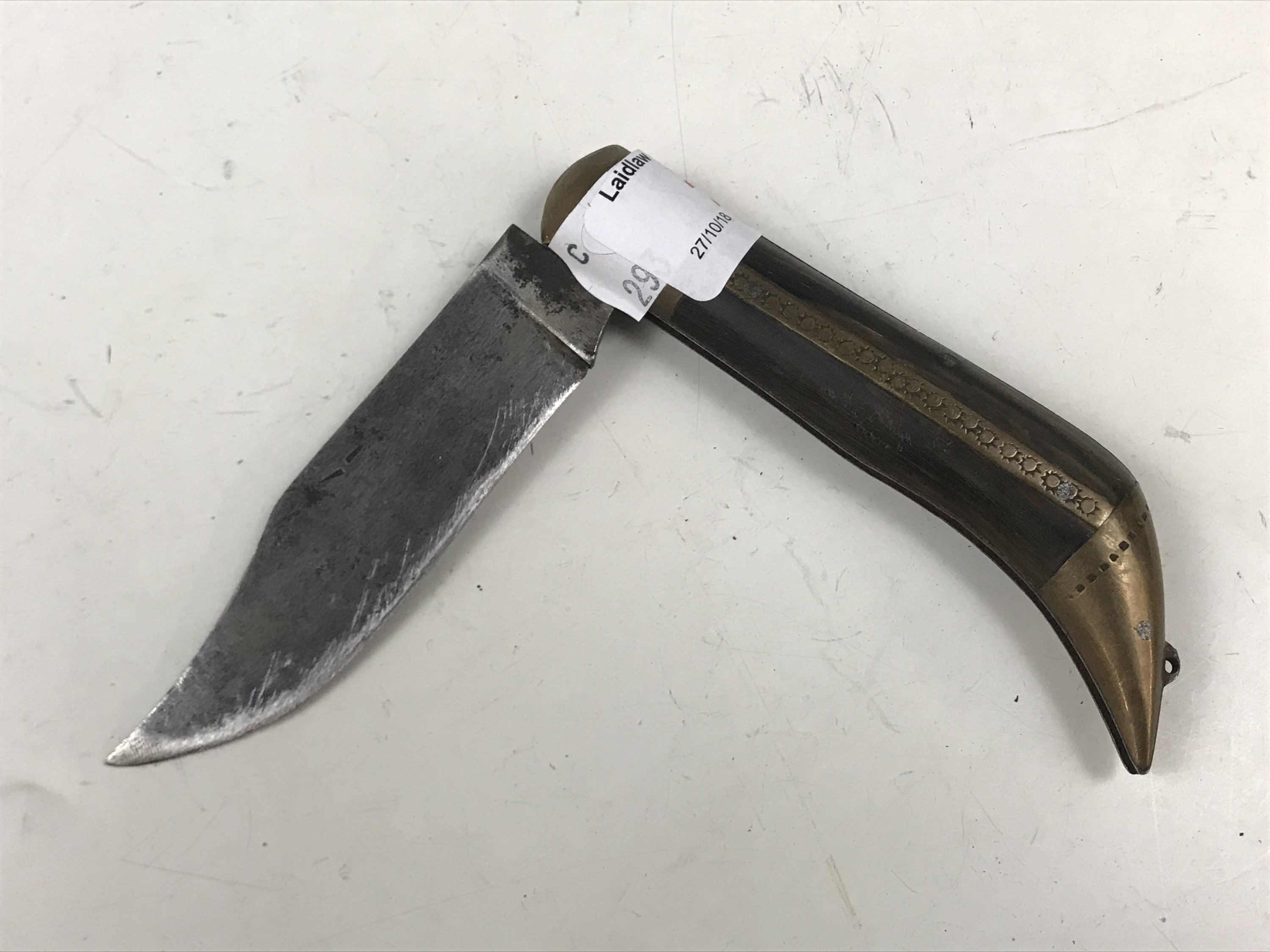 Lot 21 - An antique folding clasp knife with horn grip scales