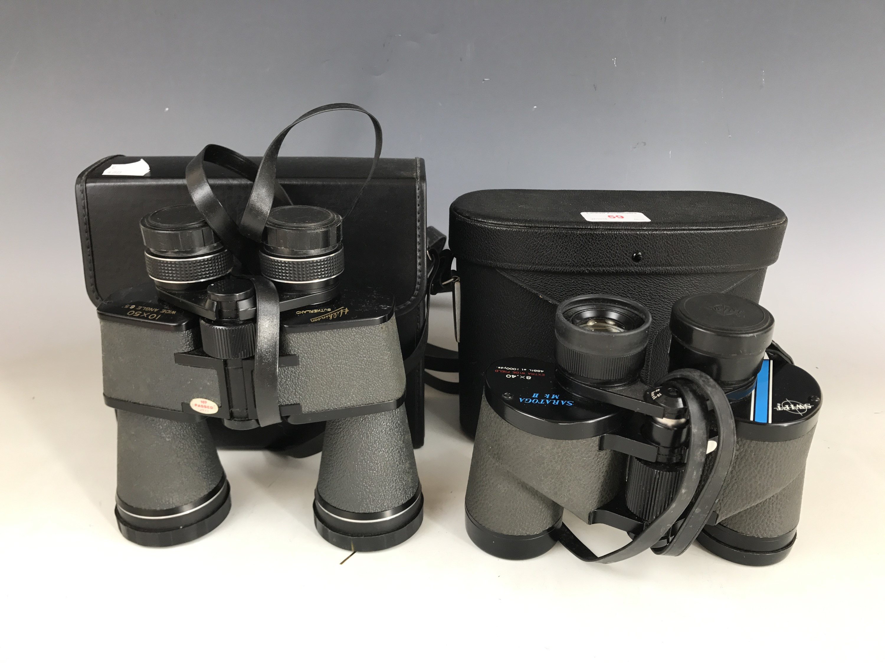 Lot 59 - A cased pair of Swift Saratoga MKII 8 x 40 binoculars together with a cased pair of Hilkinson 10 x