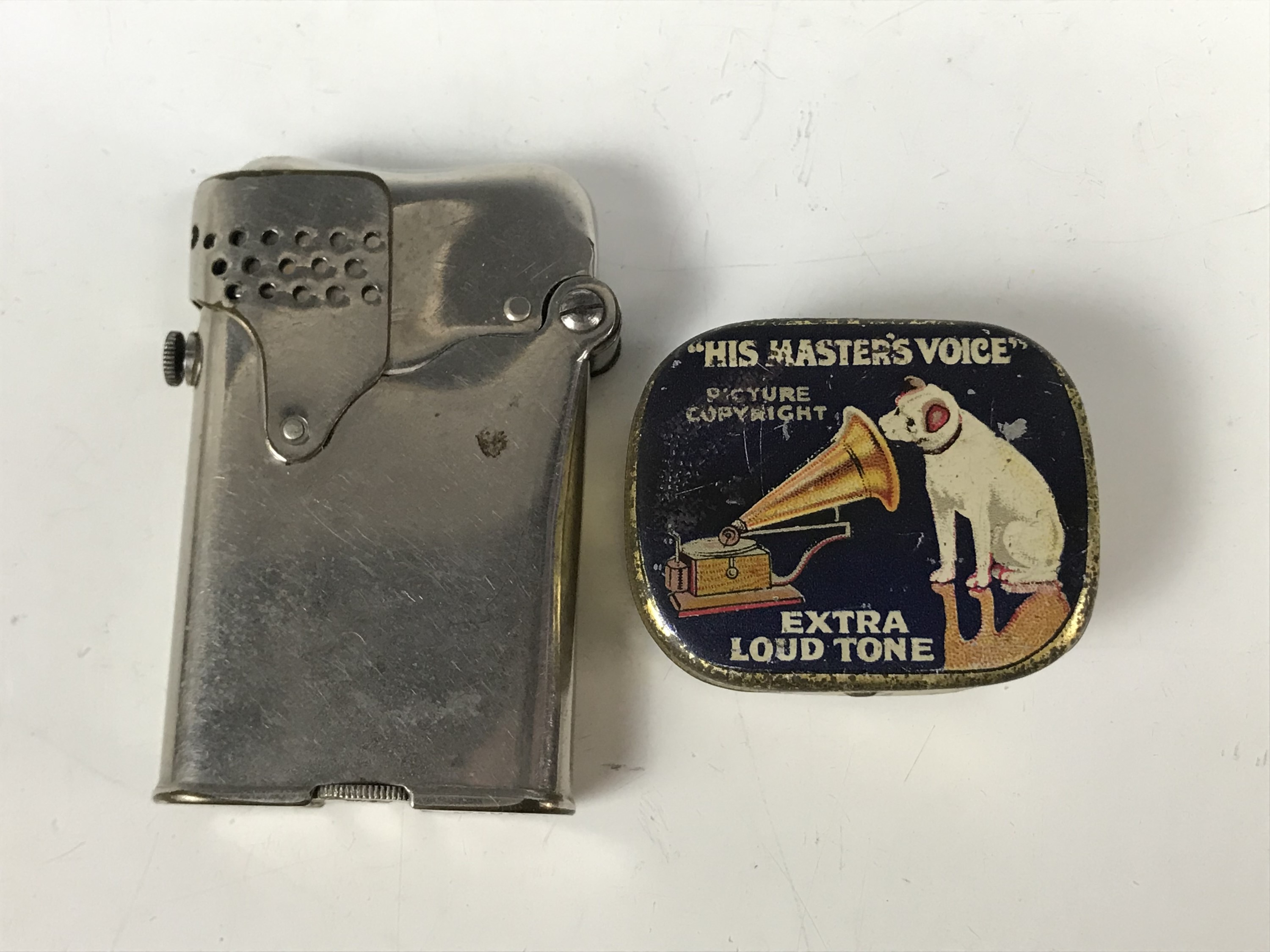Lot 11 - A HMV gramophone needle tin together with a 1920s Horens cigarette lighter