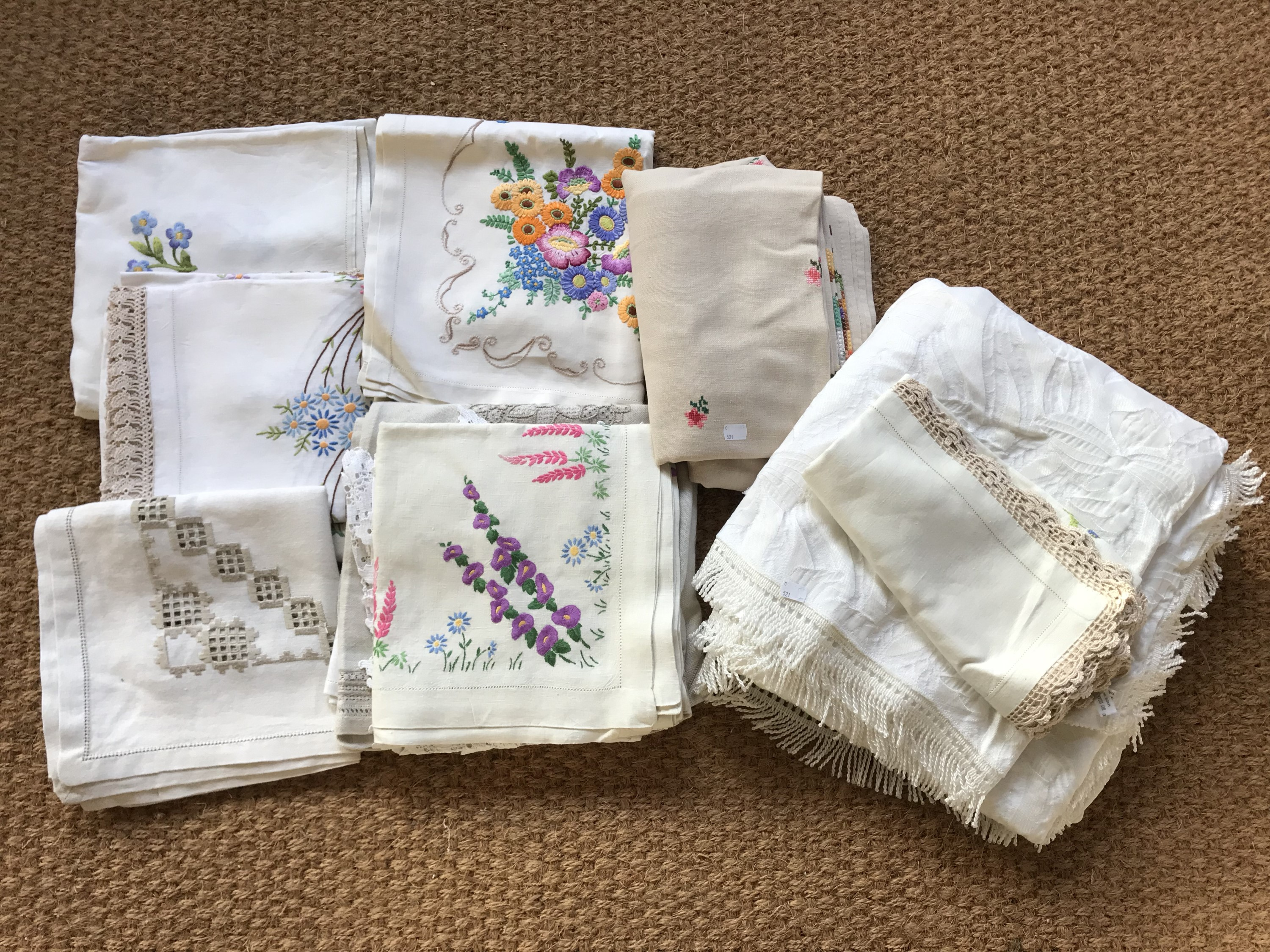 Lot 59 - Vintage hand-embroidered table linens, decorated with satin-stitched flowers etc.