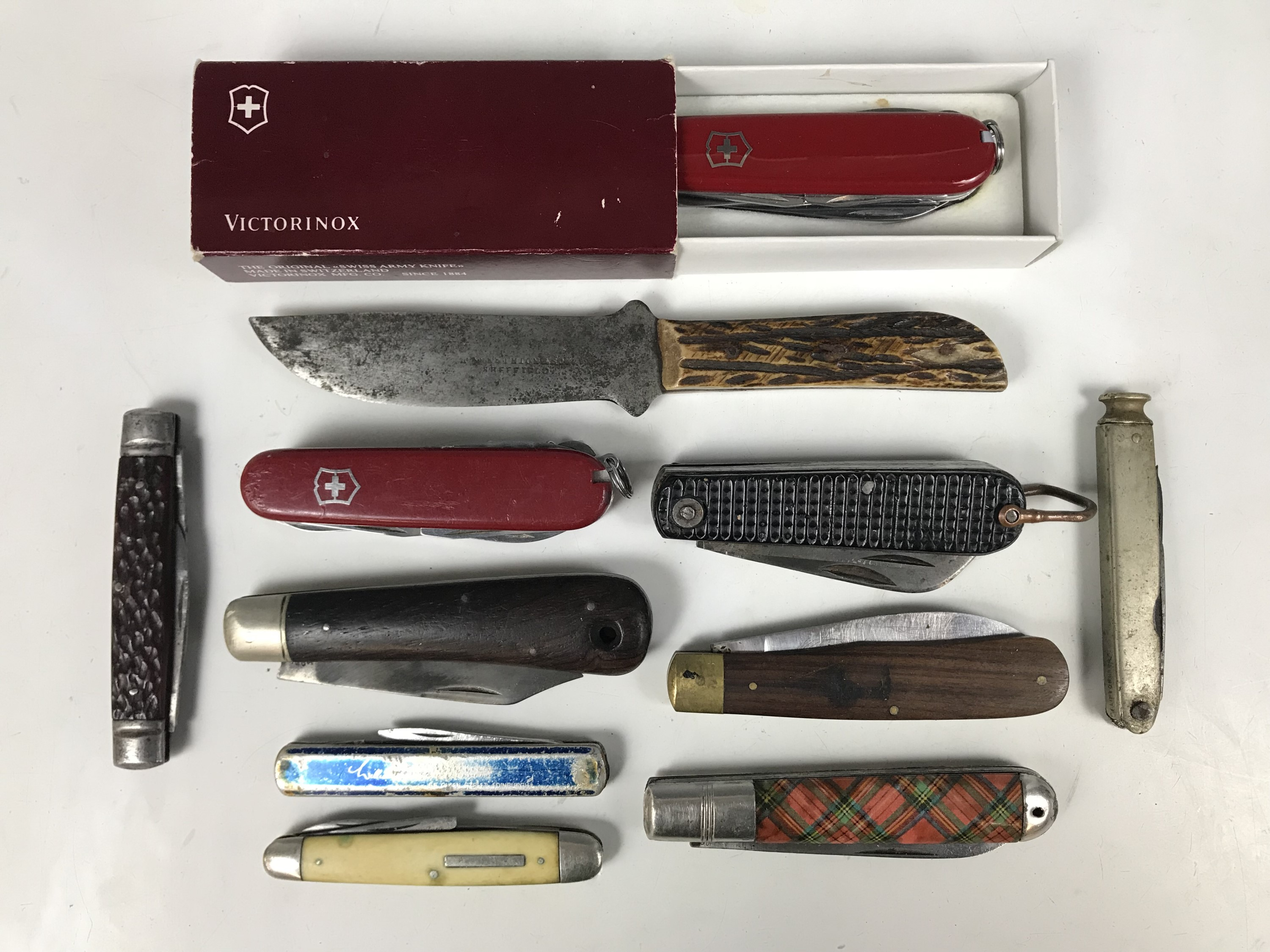 Lot 43 - Two Swiss army knives together with nine other pen knives