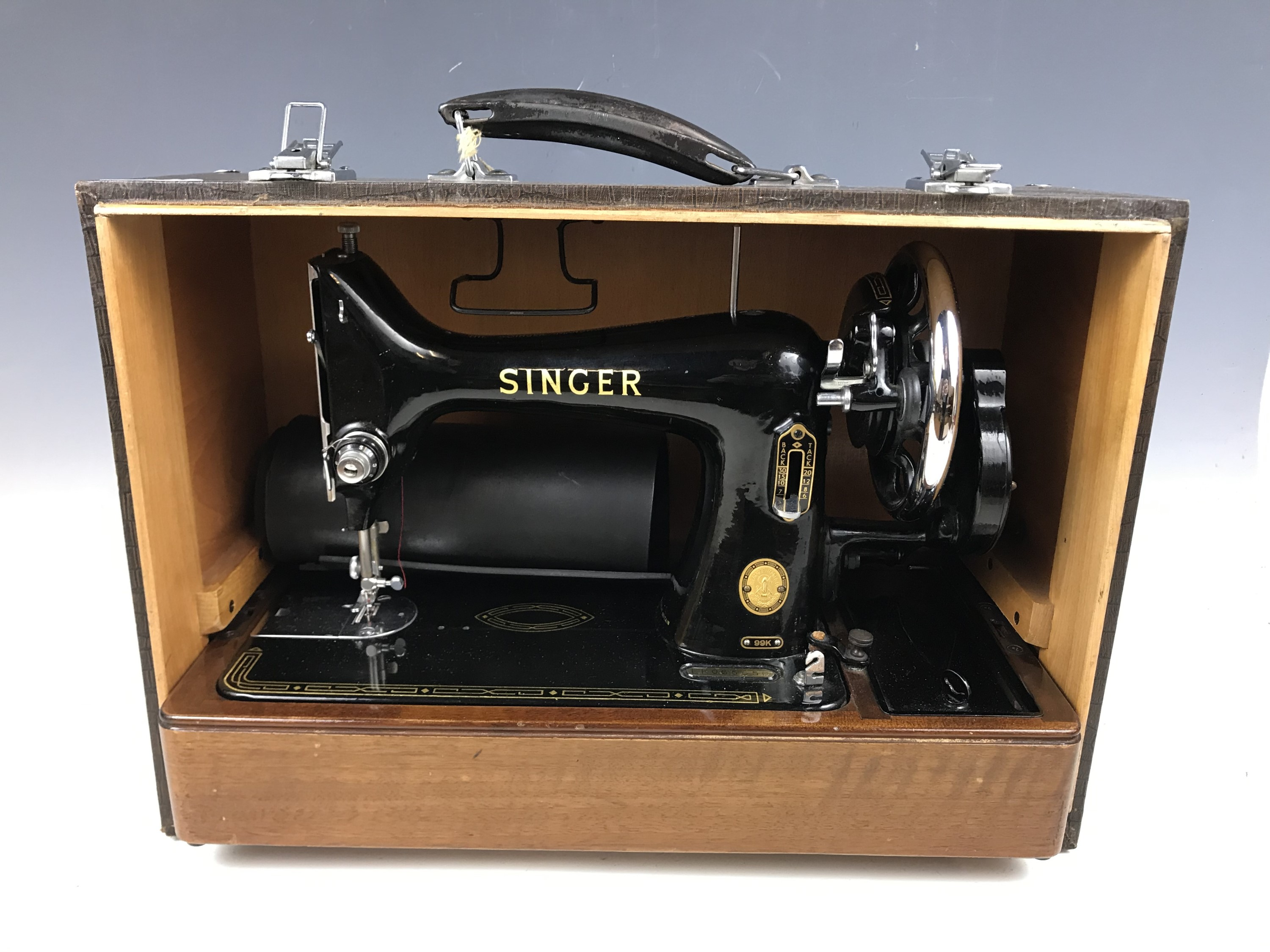 Lot 21 - A cased 1950s Singer sewing machine