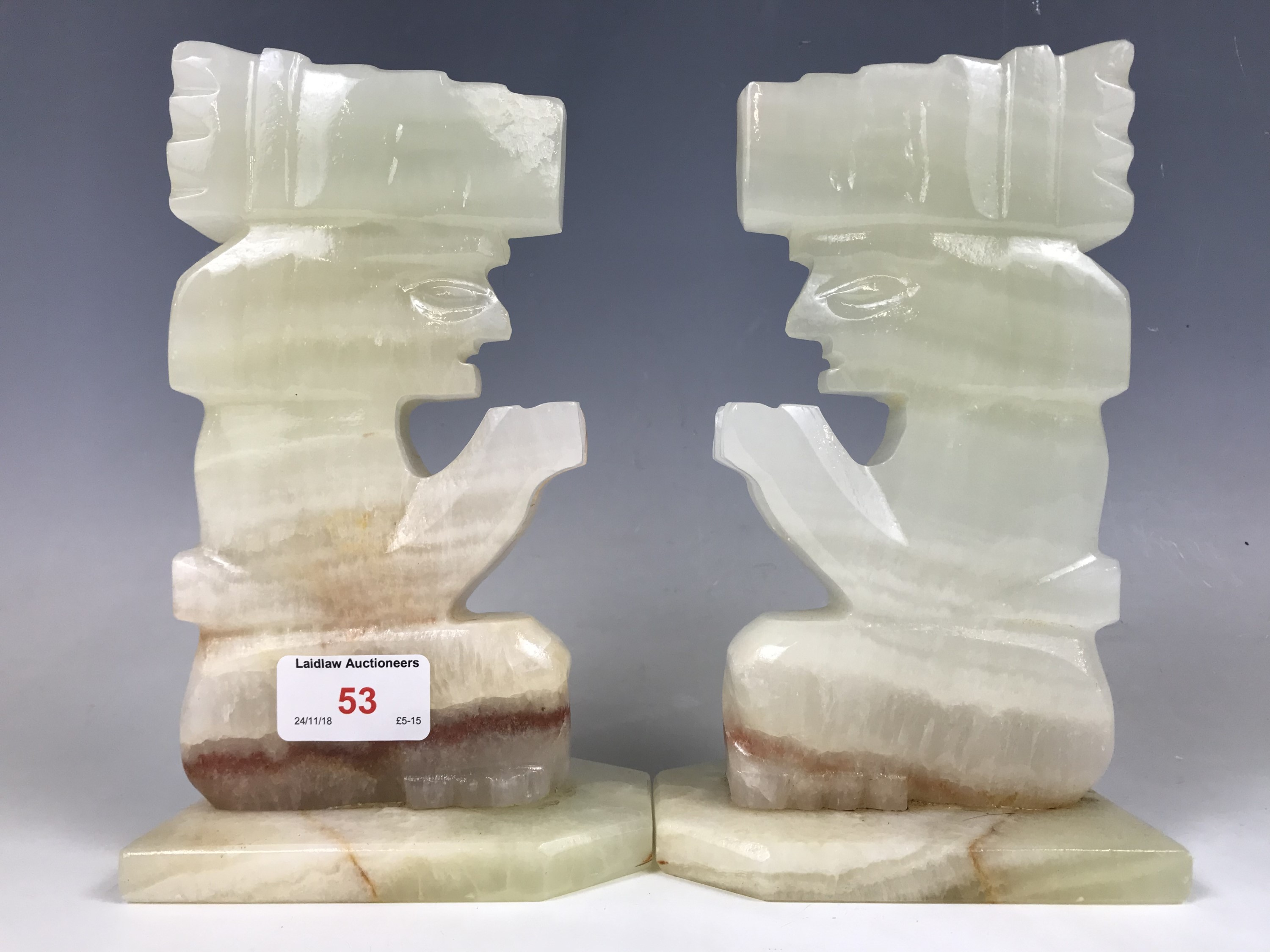 Lot 53 - A pair of green onyx bookends carved in the form of Native Americans