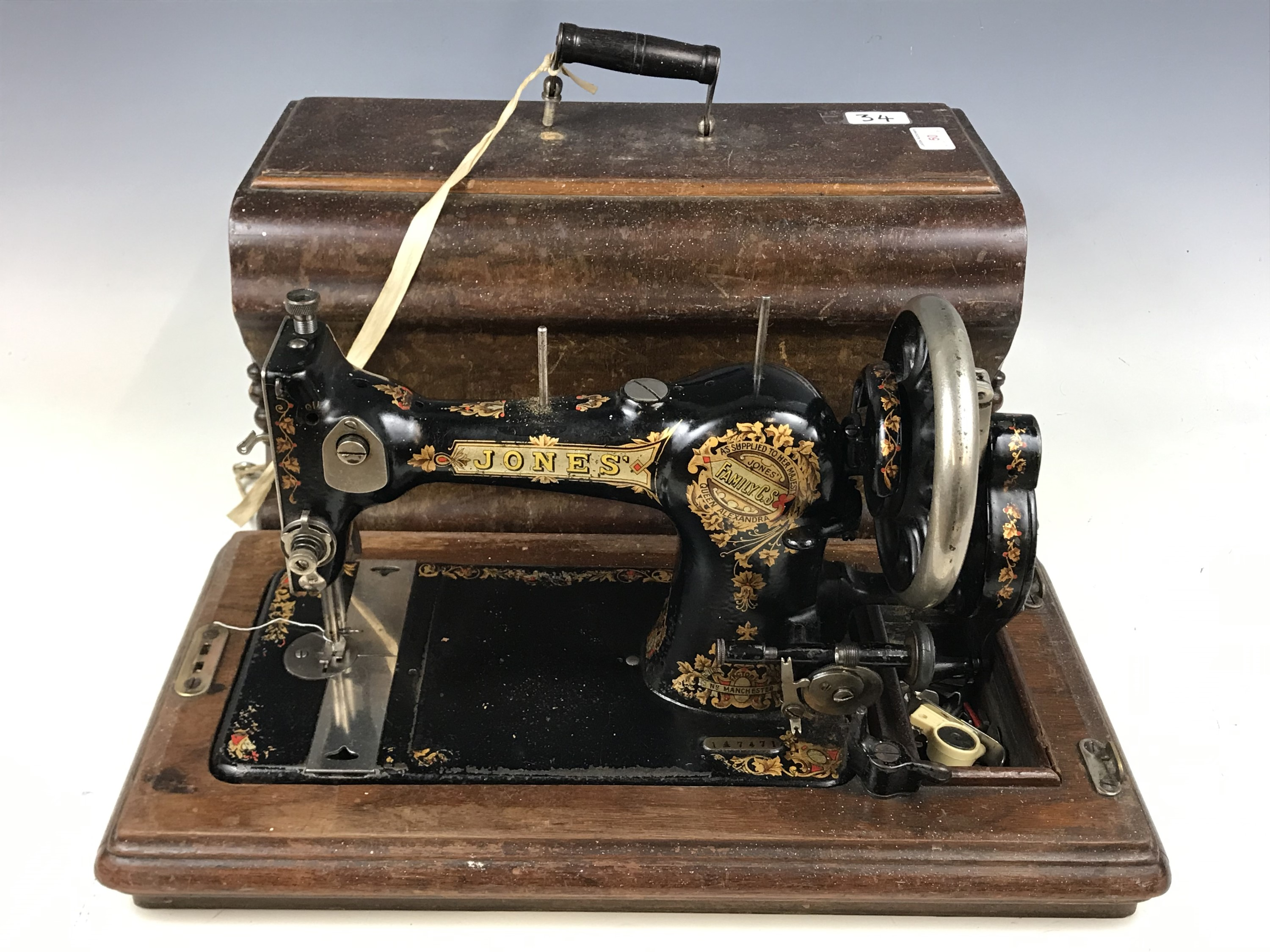 Lot 50 - An early 20th Century Jones Family CS sewing machine with case