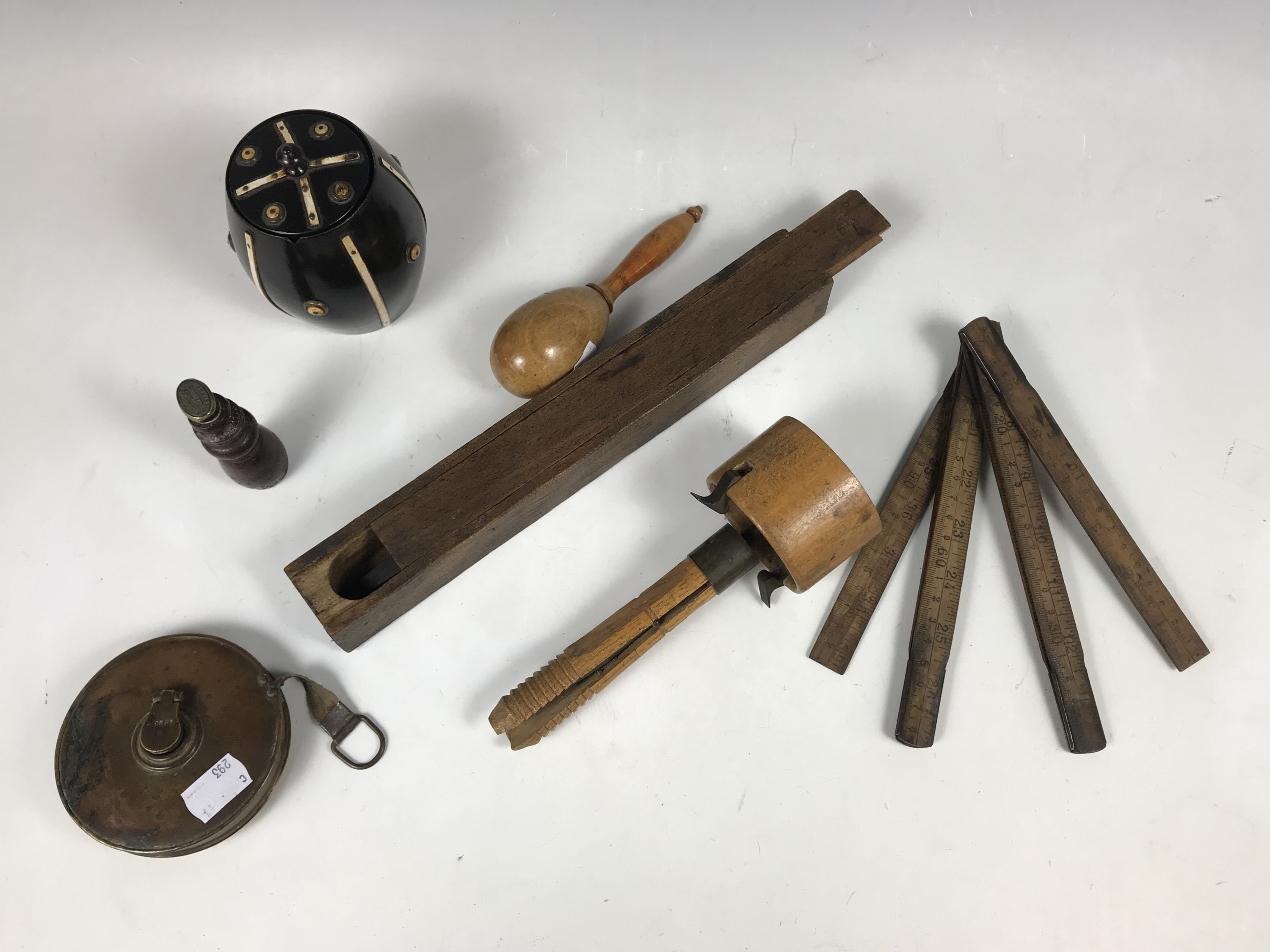 Lot 15 - Collectors' items including a cased woodworking bit, a turned beech darning egg, a wood and brass
