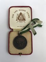 Lot 17 - A cased Royal Life Saving Society bronze medal awarded to A R Taylor, July 1936