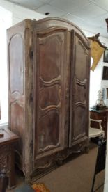 Lot 1789 - LARGE FRENCH WALNUT ARMOIRE the arched top above a pair of triple panelled doors, height 280cm