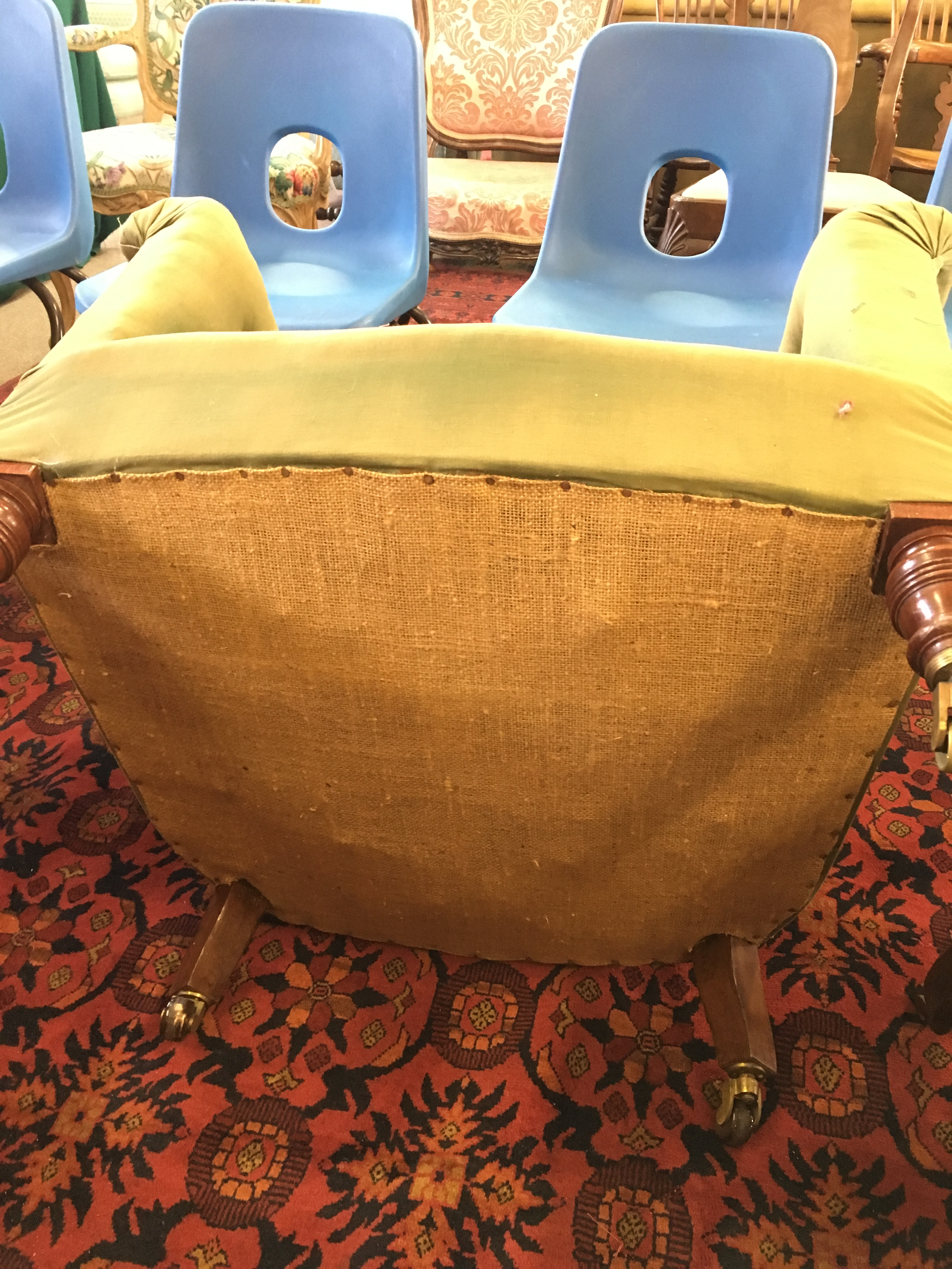 Lot 1792 - HOWARD & SONS TUB CHAIR, with curved back and slightly outswept arms, a rear leg stamped 10383 3795,
