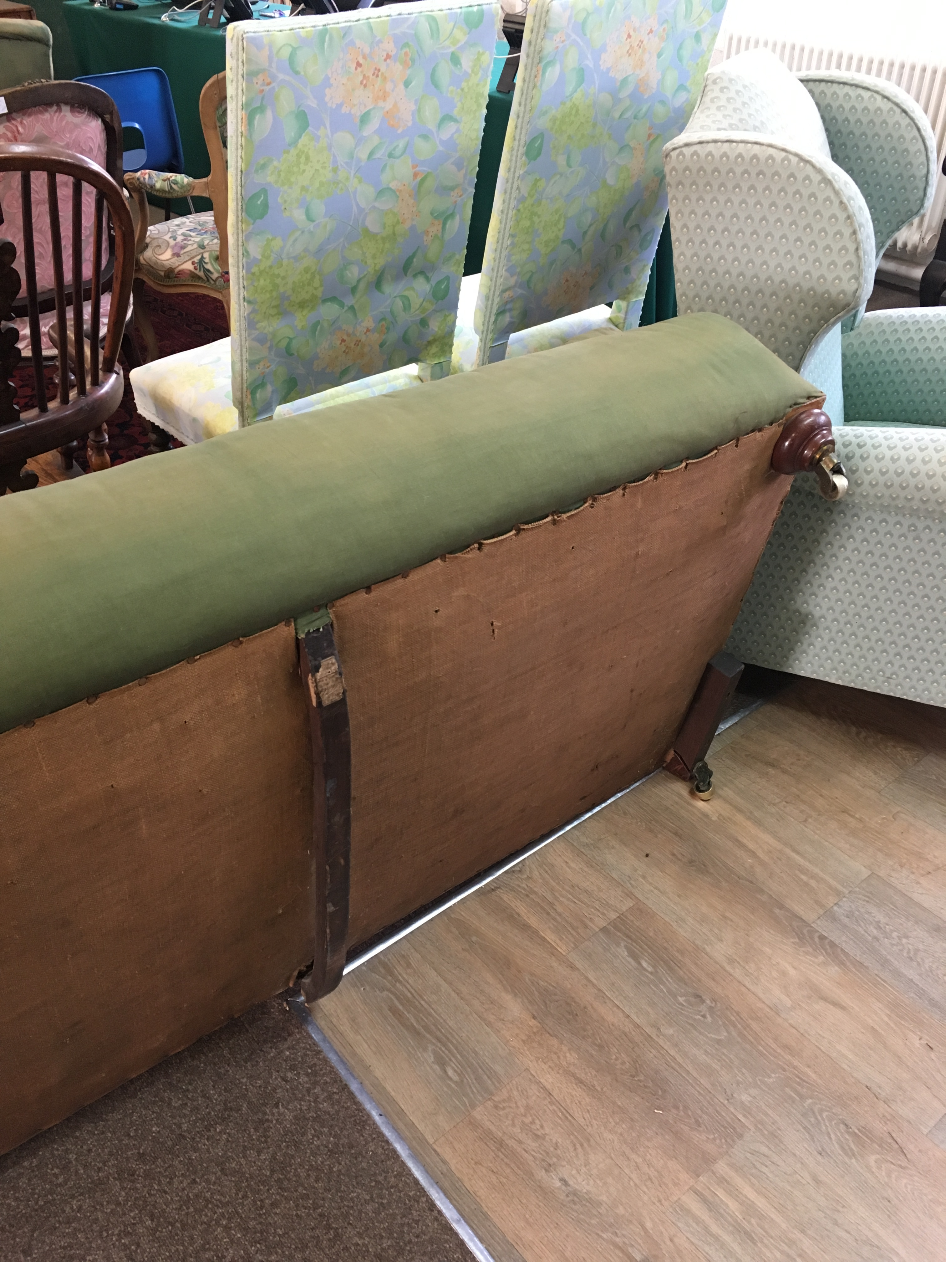 Lot 1791 - HOWARD & SONS SETTEE, with slightly scrolled back and arms, remains of paper label to frame, one