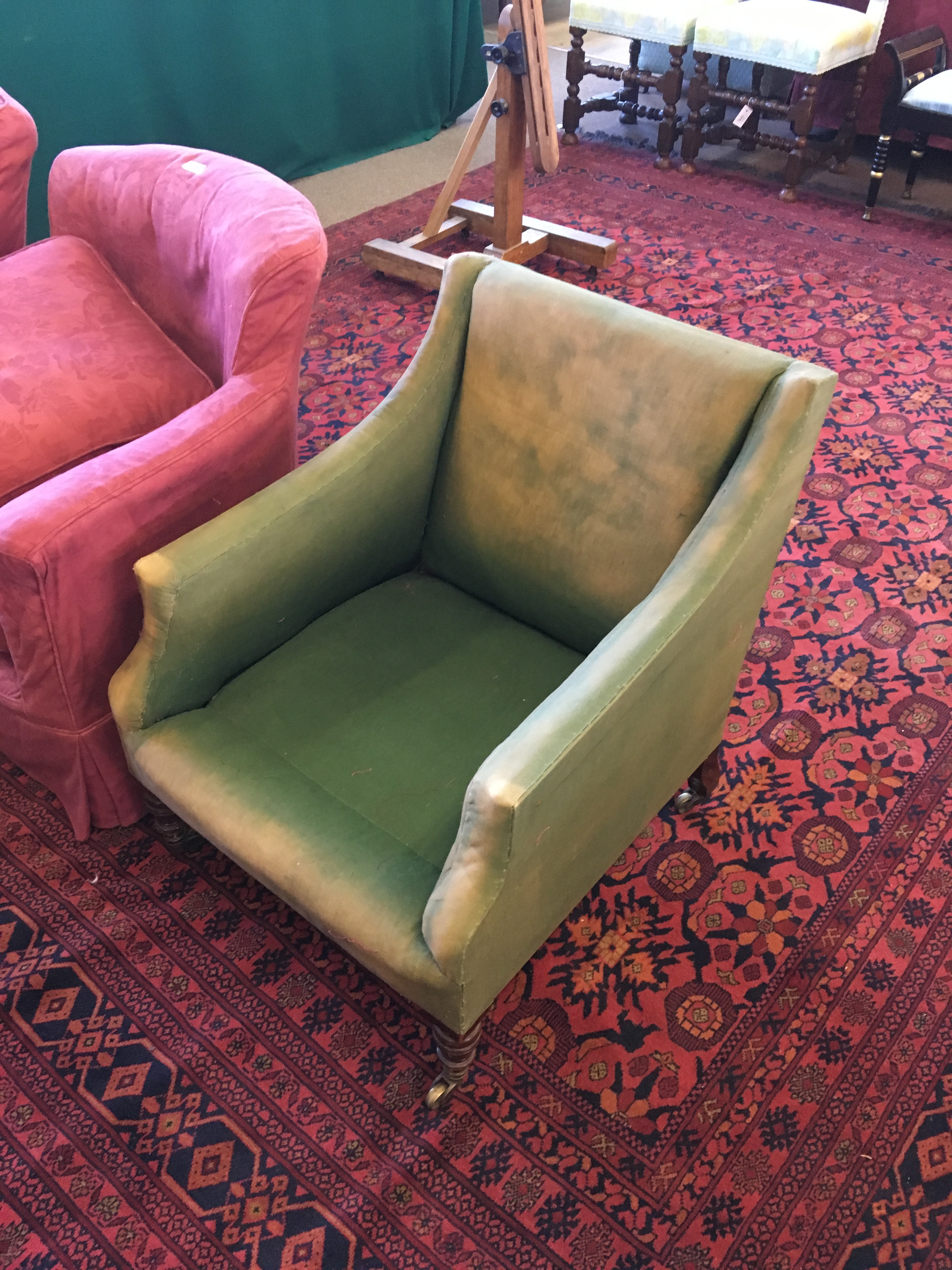 Lot 1794 - HOWARD & SONS BERGERE STYLE ARM CHAIR, with a square back and down swept arms, a rear leg stamped