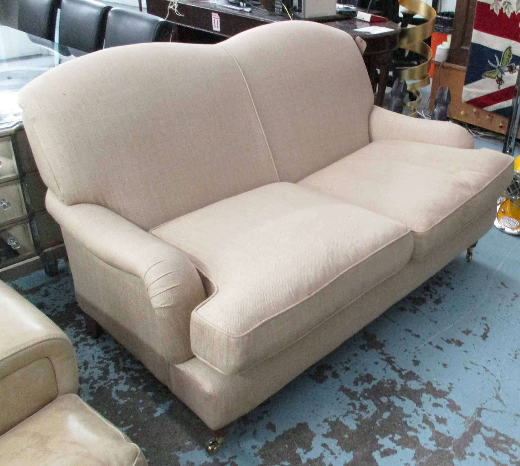 Lot 42 - LAURA ASHLEY SOFA, two seater, howard style, in brown herringbone fabric, on turned castor supports,