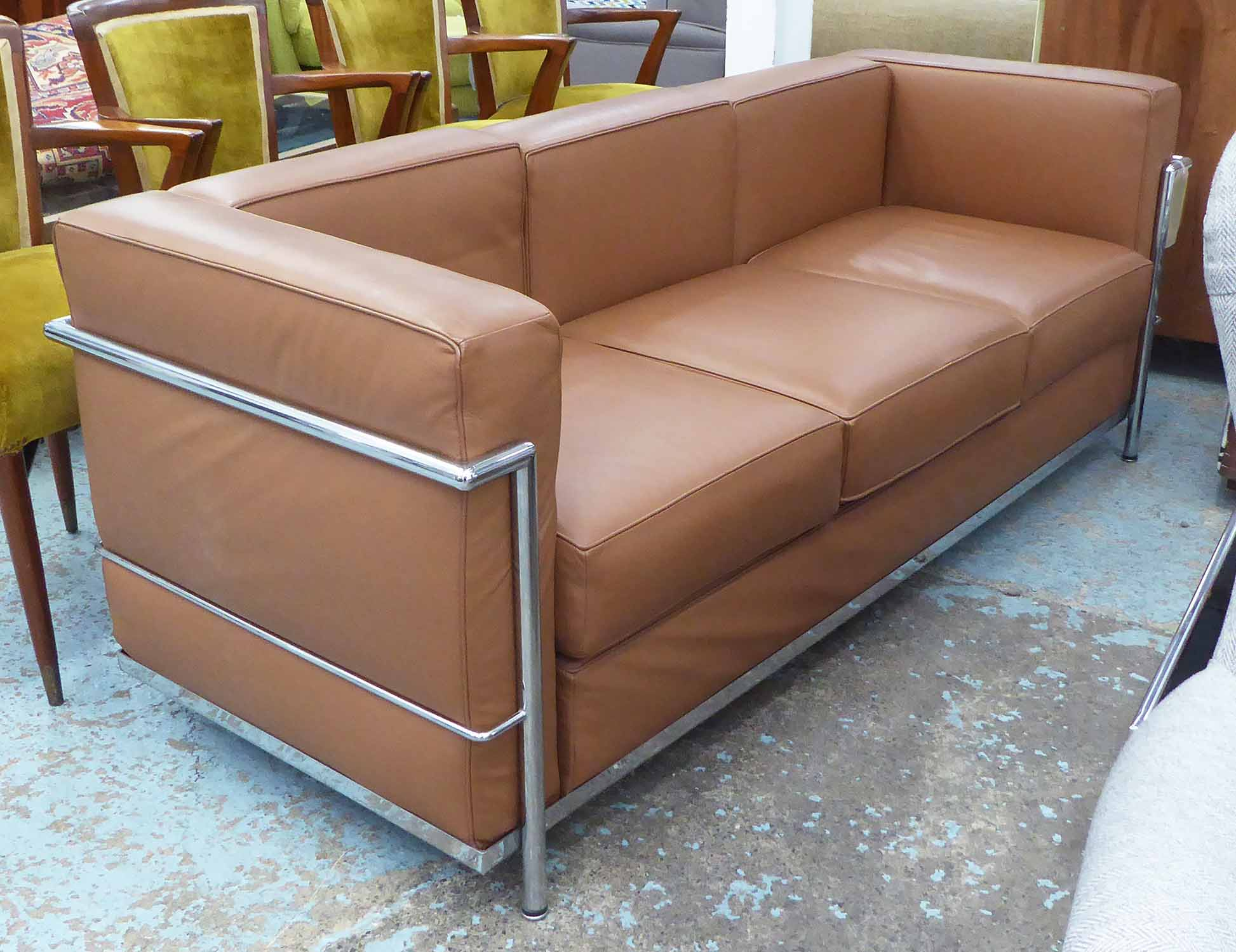 Lot 21 - SOFA, after Corbusier tubular metal frame brown leather upholstery, 180cm x 70cm.