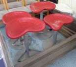 Lot 35 - BAR STOOLS, a set of four, adjustable, red tractor style seats.
