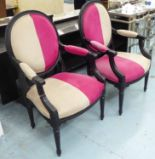 Lot 23 - OPEN ARMCHAIRS, a pair, French style, in pink and beige fabric, on an ornate ebonised frame, 63cm W.