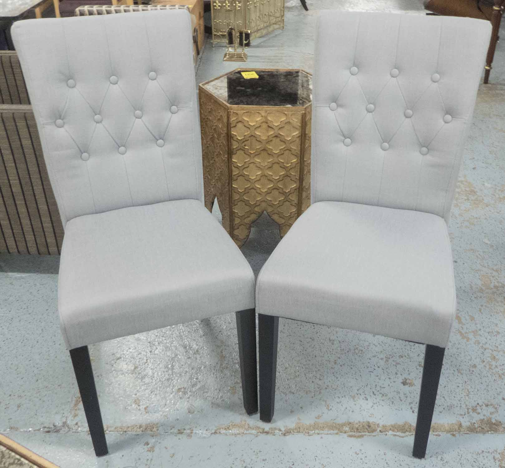 Lot 47 - DINING CHAIRS, a set of four with buttoned backs, in light blue upholstery on ebonised legs, 44cm W.