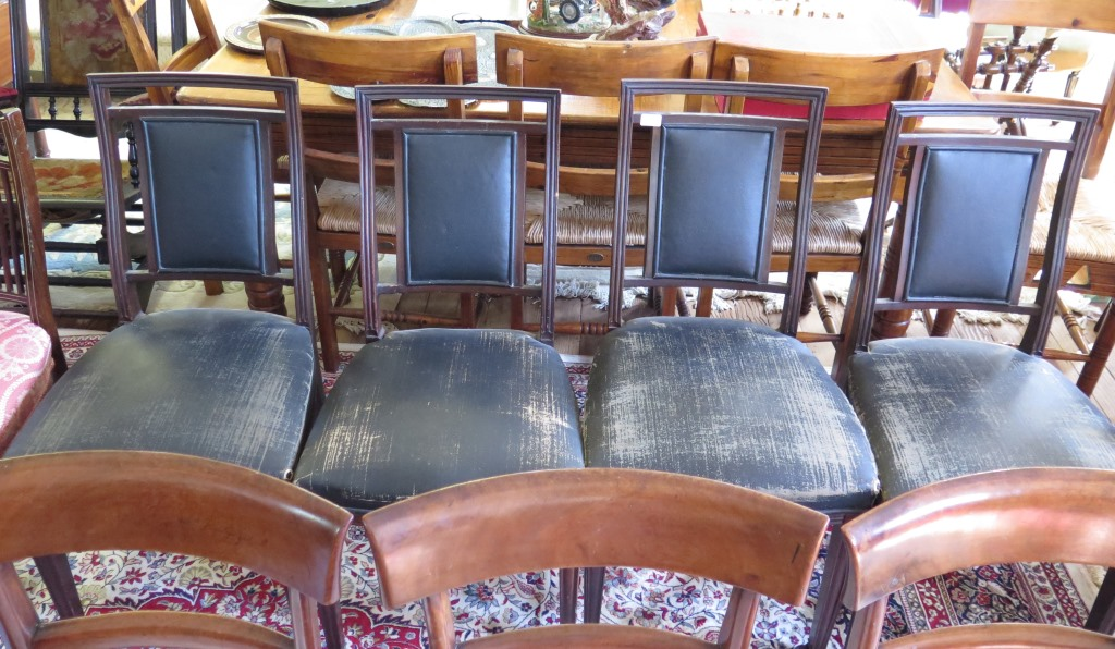 Lot 41 - A set of four Victorian mahogany dining chairs, the square backs with upholstered panels,