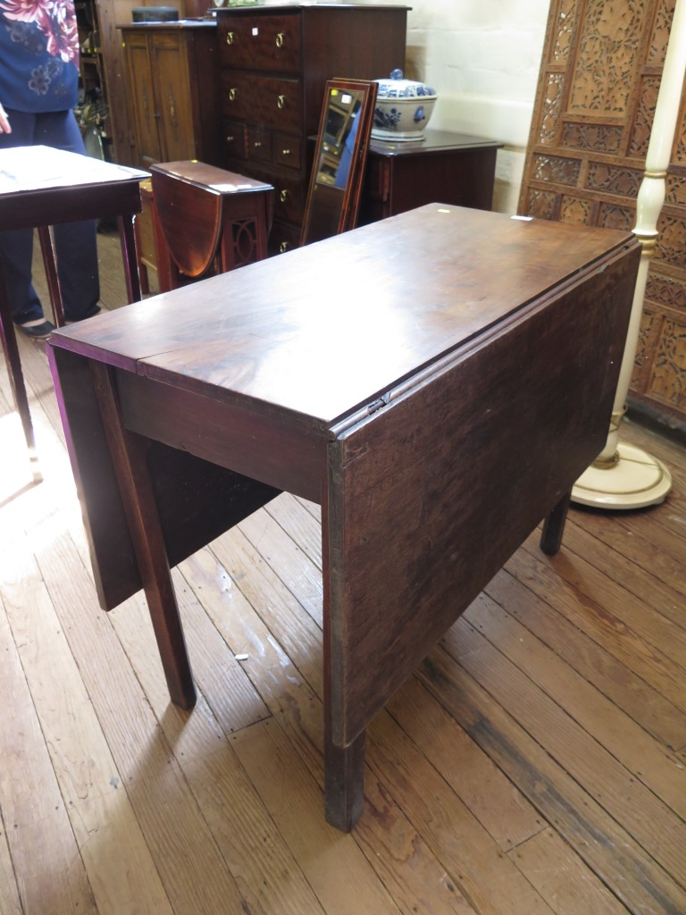 Lot 59 - A George III mahogany gateleg table, the rectangular top on square chamfered legs 99cm wide