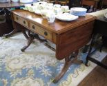 Lot 32 - A reproduction George III style yewwood sofa table, with two frieze drawers over lyre shape supports