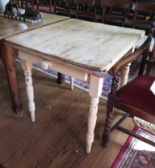 Lot 57 - A painted pine kitchen table, with frieze drawer on turned tapering legs 82cm x 73cm x 78cm wide