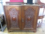Lot 3 - A late Victorian walnut side cabinet with a pair of ornately scroll carved and cabochon doors on