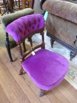 Lot 38 - A Victorian ebonised nursing chair with button upholstered back and fluted supports and another