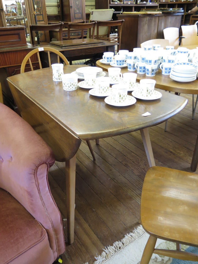 Lot 35 - An Ercol elm top drop leaf table, on tapering square legs 113cm wide, and four Ercol hooped back