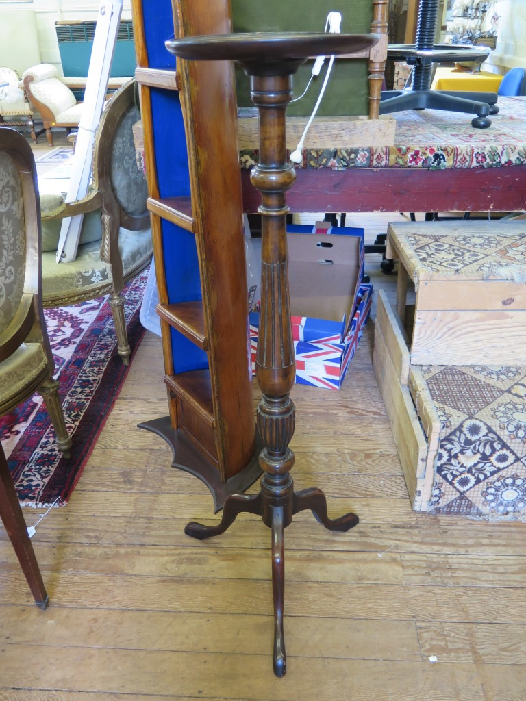 Lot 33 - A mahogany baluster form jardiniere stand, with circular top and tripod base, 106.5cm high