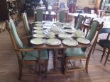 Lot 2 - An Ercol dark oak extending dining table and six chairs, including two carvers on turned supports,