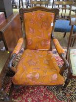 Lot 35 - An early Victorian open armchair with upholstered back and seat on lotus carved legs