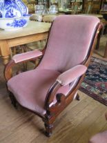 Lot 37 - An Early Victorian mahogany armchair, the scrolled upholstered back and open arms on lobed
