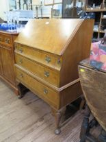 Lot 13 - A burr walnut bureau, the sloping fall over three drawers on shell carved cabriole legs with club