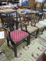 Lot 52 - Two George III elm carver dining chairs, with pierced vase shape splats and square legs joined by