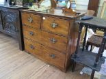 Lot 62 - A varnished pine chest of drawers, with two short and two long drawers on bracket feet, 89cm wide