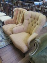 Lot 39 - A reproduction Victorian style button back fireside chair on turned legs and another similar (2)