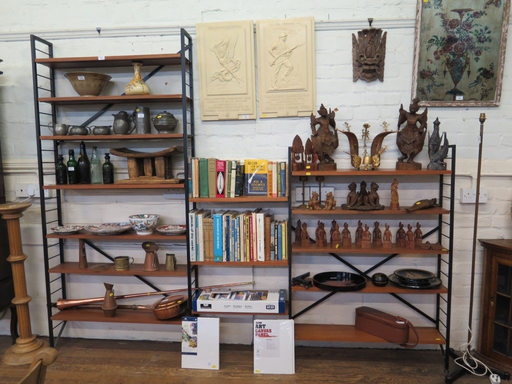 Lot 18 - A three section Ladderax bookcase with two tall and two short supports with single foot, and fifteen