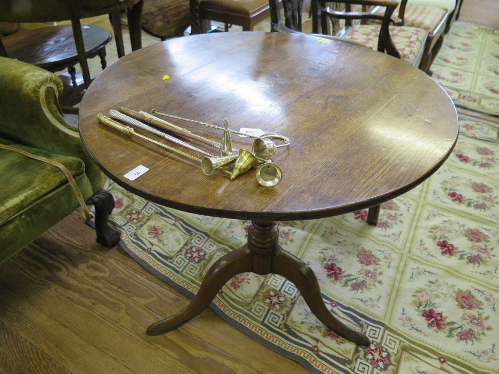 Lot 50 - A George III oak tripod table, the circular snaptop on a baluster turned stem and cabriole legs,