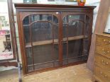 Lot 56 - A Victorian mahogany bookcase top, the part protruding cornice over a pair of glazed doors, 161cm