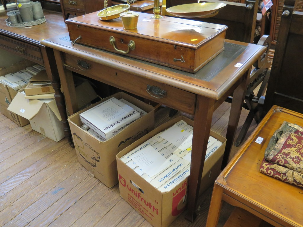 Lot 9 - A walnut writing table, the leather inset top over a long drawer on square tapering legs and pad