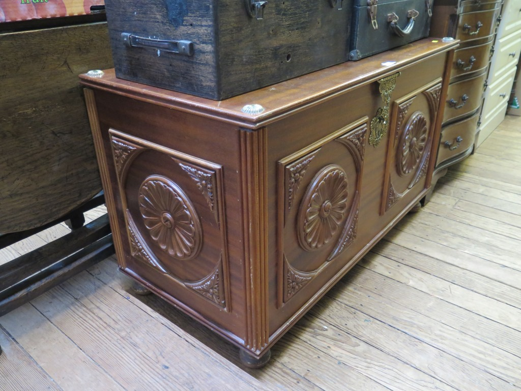 Lot 16 - A reproduction serpentine crossbanded mahogany chest, with slide and four long graduated drawers,