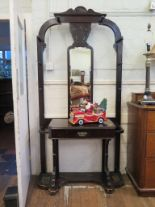 Lot 21 - A late Victorian ebonised hall stand, with mirror back, frieze drawer and umbrella stands, 103cm