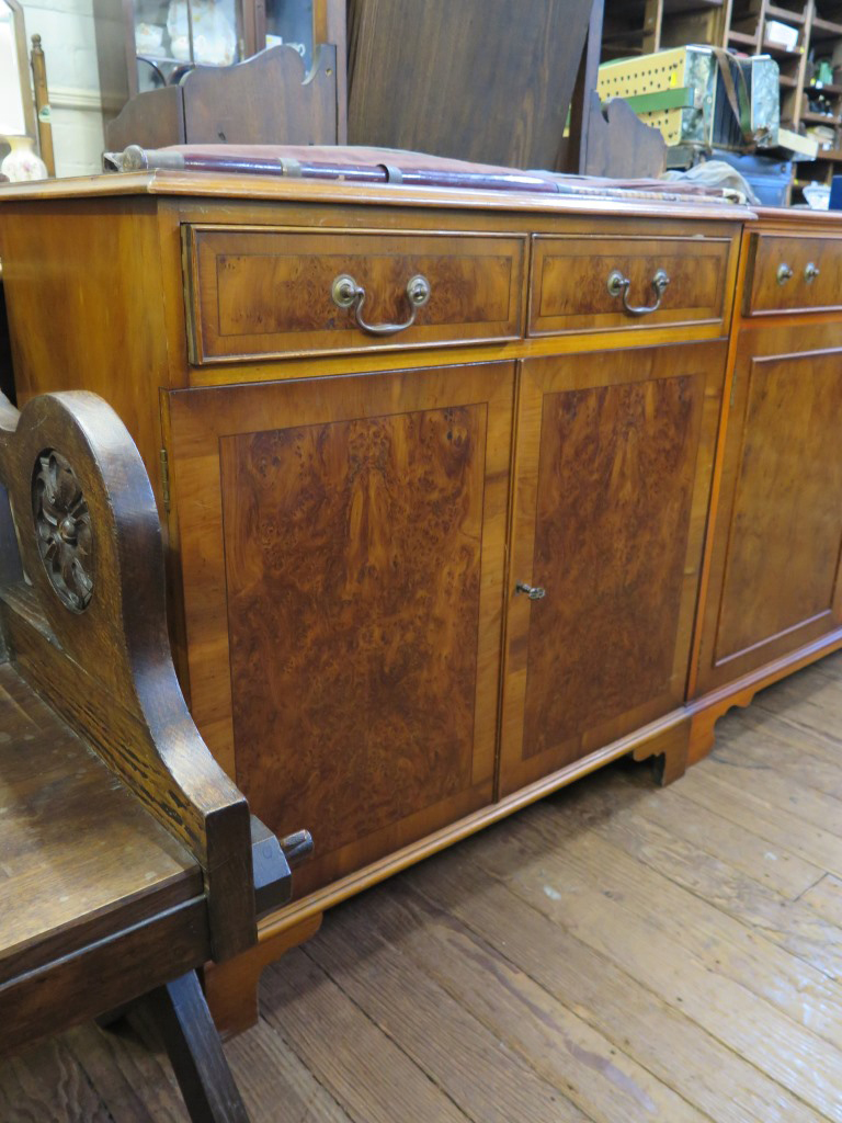 Lot 11 - A Bevan Funnell Reprodux crossbanded yew-wood side cabinet, with two short drawers and twin doors